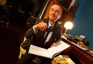 Rafal Lukawiecki Signing a Copy of His (Be)Longing Photo Book