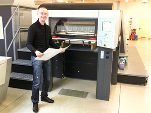 Proudly holding a test run sheet at the back of a Heidelberg Speedmaster