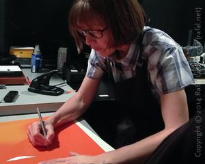 Anne Larsen Cuts a Masked Flashing Mask